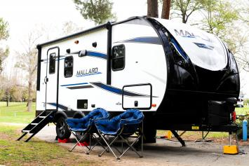 New Luxury travel trailer with awning and king size bed