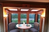 Unique atrium slideout dinette with skylights and windows on 3 sides offers a beautiful view of the outdoors and lots of daylight. All windows have day/night shades for privacy.