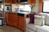 Custom maple cabinetry, corian countertops, large double door fridge/icemaker, double sink, filtered water dispenser, large convection/microwave