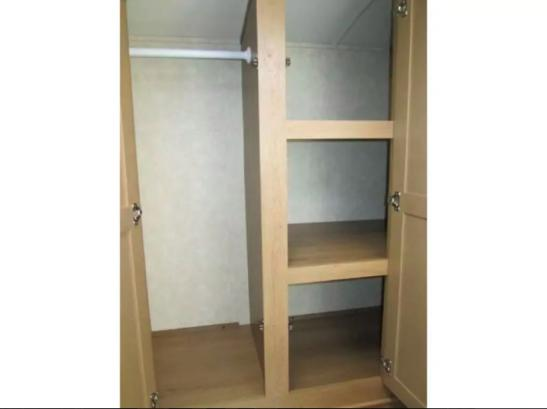 Large closet and storage in bathroom.