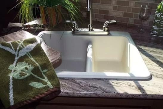 This luxury RV has a double-sided porcelain sink, brushed hardware and granite-finish countertops.