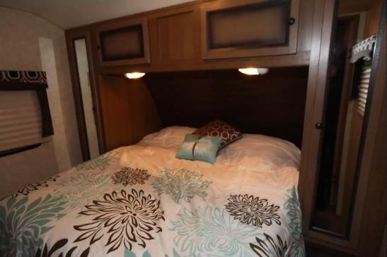 Queen bed in private Master bedroom with wood door. 2 closets and extra storage in Master as well.