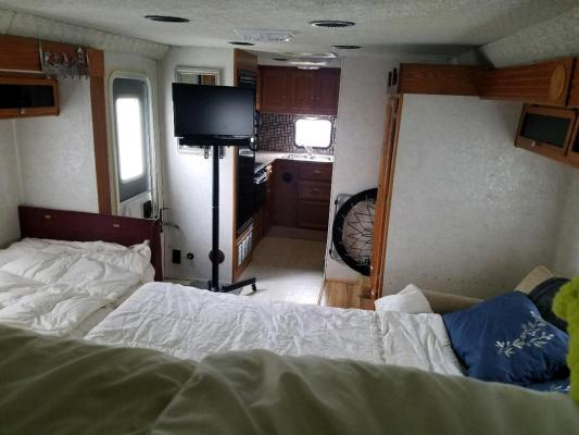 View from over cab bunk with beds converted