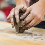 Hands molding clay