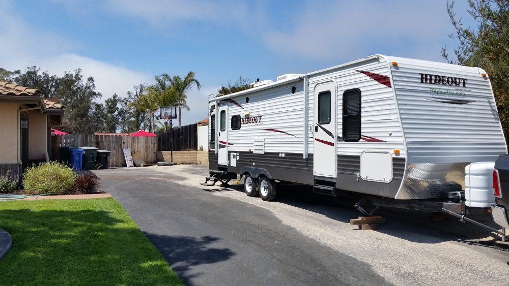 Travel Trailer set up in driveway of home