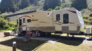 Travel trailer set up at Plaskett Creek Campground near Big Sur California