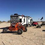 RV Rental in desert with ATV's in Sand