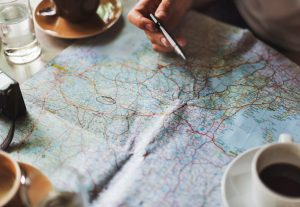 person looking at a map and planning an RV vacation