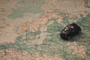 toy car sitting on a map