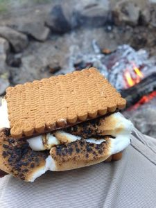 s'mores next to a campfire