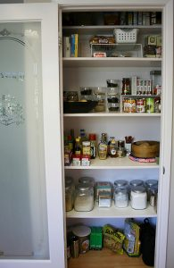pantry filled with storage containers in an RV