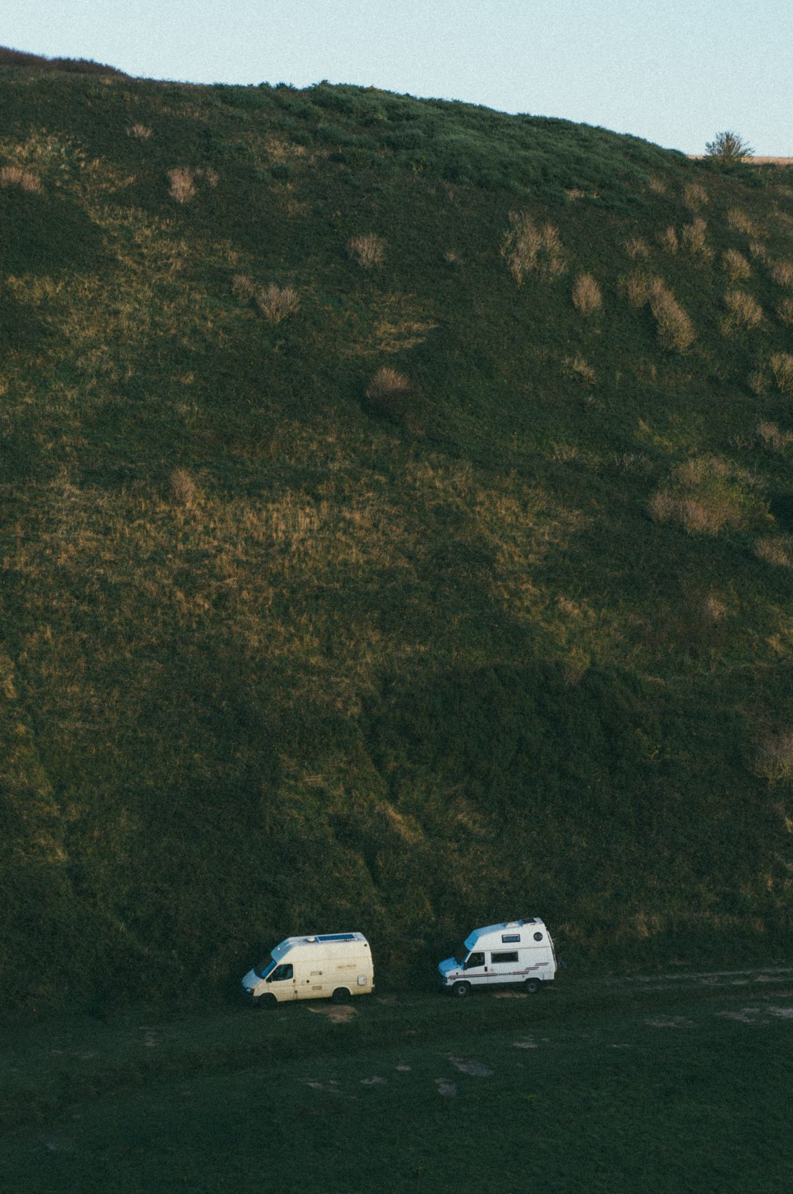 two RVs driving to a dispersed camping location