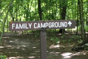 wooden family campground sign in forest