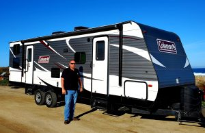 Erik Abbott in front of his RV rental