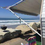 RV set up in front of ocean campsite