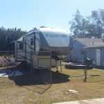 RV set up at side of home
