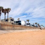 row of RV camping by the beach