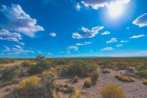 blue sky with clouds and dessert landscape