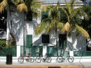 bicycles and palm trees in front of a white house in Key West, Florida